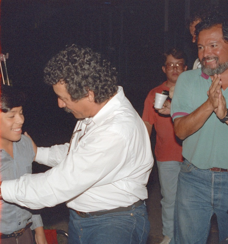 Severo Perez congratulates José Alcala at the wrap party as Assistant Director John Acevedo looks on. <br /><br />