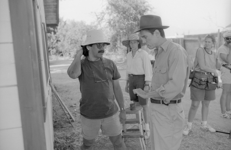 Severo Perez and Marco Rodriguez confer on the set of &quot;...and the earth did not swallow him.&quot; <br /><br /> Photograph by Carlos Rene Perez. Severo Perez Papers, Wittliff Collections, Texas State University.