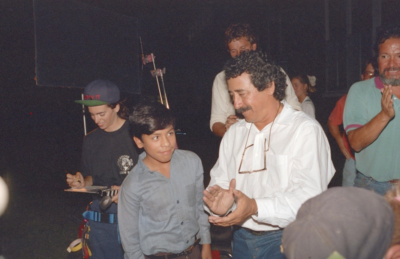 Severo Perez applauds José Alcala at the wrap party, September 13, 1992. <br /><br />