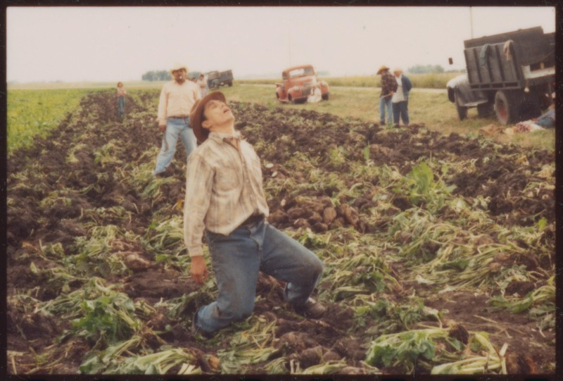Joaquin (Marco Rodriguez) suffers heat stroke working in the fields. <br /><br /> Photograph by Carlos Rene Perez. Severo Perez Papers, Wittliff Collections, Texas State University.