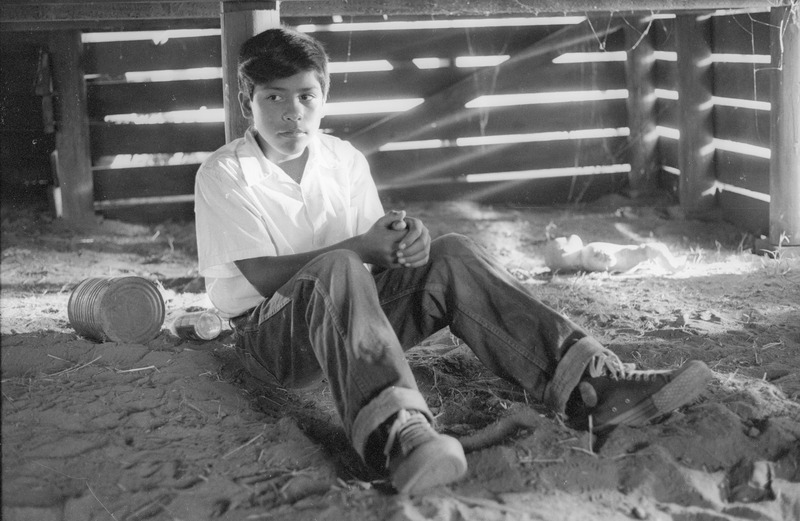 José Alcala as Marcos during the filming of the &quot;under the house&quot; scene. <br /><br /> Photograph by Carlos Rene Perez. Severo Perez Papers, Wittliff Collections, Texas State University.
