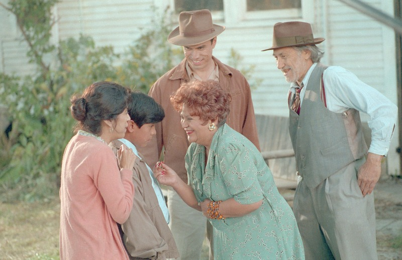 Sam Vlahos, far right, as Don Cleto. Also pictured, left to right: Rose Portillo as Florentina, José Alcala as Marcos, Lupe Ontiveros as Dona Rosa, and Marco Rodriguez as Joaquin. <br /><br /> Photograph by Carlos Rene Perez. Severo Perez Papers, Wittliff Collections, Texas State University.