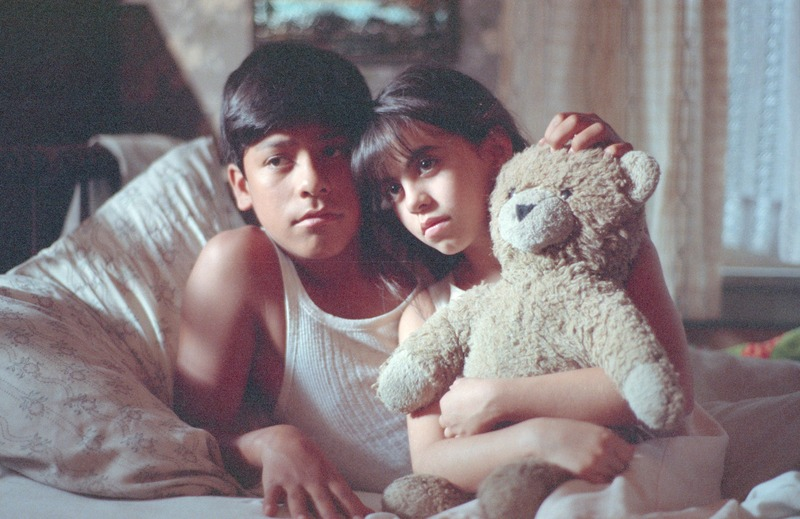 Marcos (José Alcala) comforts his sister, Consuelo (Erica Baltodano.)<br /><br /> Photograph by Carlos Rene Perez. Severo Perez Papers, Wittliff Collections, Texas State University.