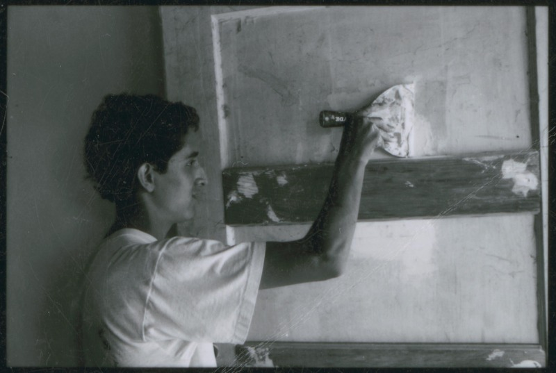 Assistant Scenic Artist Rafael Perez--the son of Severo Perez--works on the set of &quot;...and the earth did not swallow him.&quot; <br /><br /> Photograph by Carlos Rene Perez. Severo Perez Papers, Wittliff Collections, Texas State University.