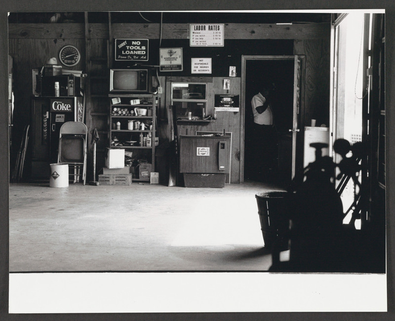 Interior, Henry Rivera&amp;#039;s body shop in Crystal City, with Henry Rivera (Tomás Rivera&amp;#039;s brother) standing behind the door. Location scouting photo by Severo Perez. &lt;br /&gt;<br />