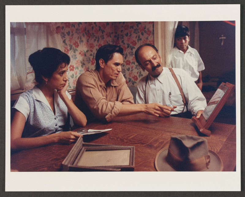 Castulo Guerra as the photo salesman shows off the fotoescultura to Joaquin (Marco Rodriguez) and Florentina (Rose Portillo) as Marcos (Jose Alcala) looks on. <br /><br /> Photograph by Carlos Rene Perez. Severo Perez Papers, Wittliff Collections, Texas State University.
