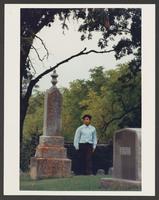 Marcos walking through cemetery