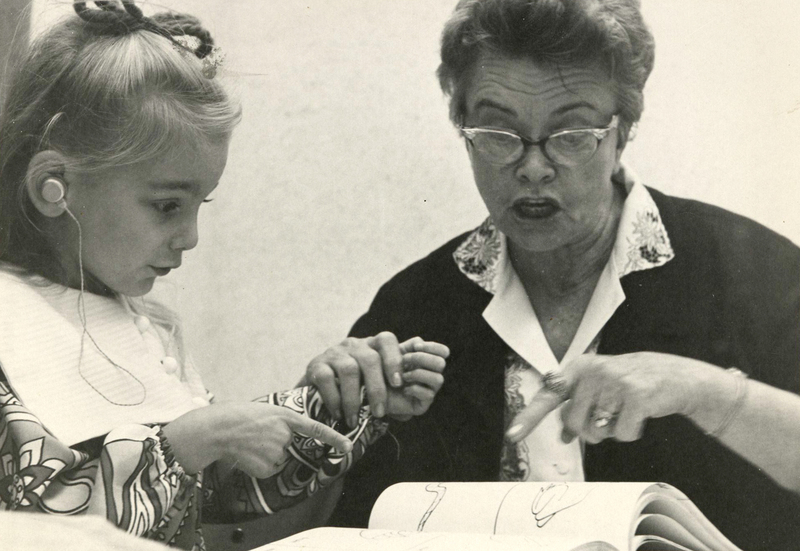 Dr. Zedler working with a child, undated.